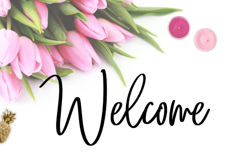 """Welcome"" in black script font on white background with pink flowers, candles, and gold pineapple charm."